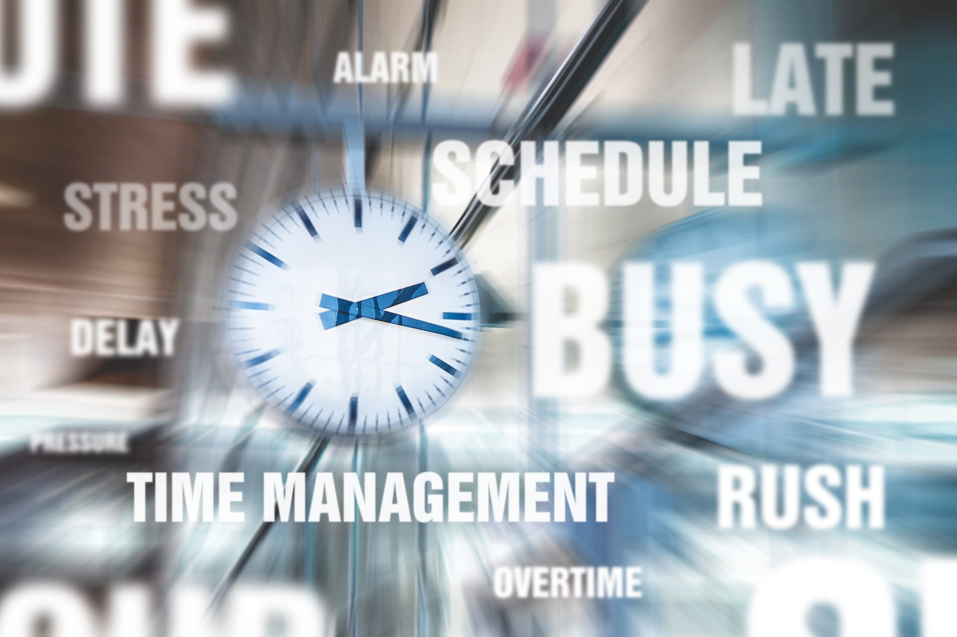 """A graphic with a stopwatch and several time-related words like """"Time Management"""" and """"Busy"""""""
