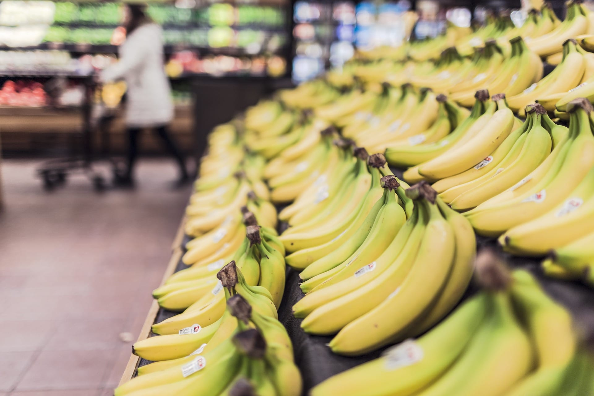 A display of fresh bananas at a supermarket.